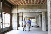 Joe Williams, left, superintendent of general contractor DTC Construction, and developer Barry Siegal discussed the Southeastern Building historic renovation project earlier this week.