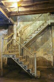 A staircase leading from the basement to the first floor.