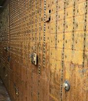 The safety-deposit boxes are rusted with disuse.