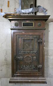 A historic letter box was used by 1920s-era bank tellers of American Exchange National Bank.