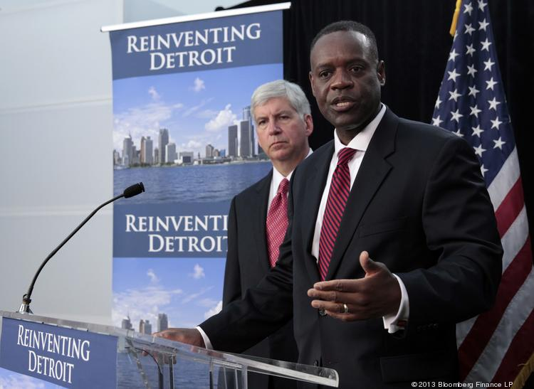 Rick Snyder, governor of Michigan, left, and Kevyn Orr, emergency manager for the city of Detroit, hold a news conference in Detroit. Detroit, the cradle of the automobile assembly line and a symbol of industrial might, filed the biggest U.S. municipal bankruptcy after decades of decline left it too poor to pay billions of dollars owed bondholders, retired cops and current city workers.