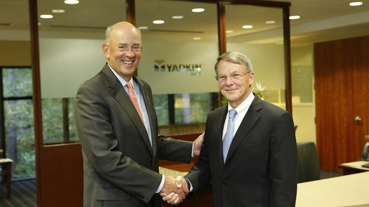 Scott Custer, CEO of Yadkin Bank, (left) and Pressley Ridgill, CEO of NewBridge Bank, announced their companies would merge in a $456 million deal Tuesday.