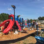 Business volunteers build playground for local school (PHOTOS)