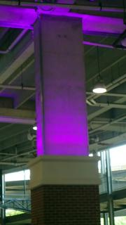 A column at M&T Bank Stadium glows in the Ravens signature purple color.
