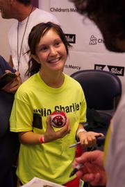 Open heart surgery patient Karly Hess, 18, listens to Paul Rudd at Children's Mercy Hospital.