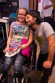Actor and Overland Park native Paul Rudd, who is in town for the upcoming Big Slick Poker Tournament, places his head on the shoulders of cancer patient Katelin Pittillo, 11, at Children's Mercy Hospital.