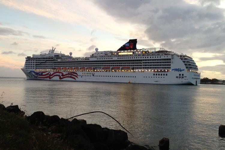 Norwegian Cruise Line's Pride of America leaves Honolulu Harbor for its interisland cruise in this 2013 file photo. An independent study commissioned by the Cruise Lines International Association found cruise ships brought $386 million in direct spending to Hawaii last year.
