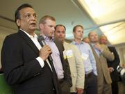 Nishit Mehta of HyGen Pharmaceuticals Inc., discusses his company's secret to success during the 2013 Eastside Fastest-Growing Private Companies Awards at the Golf Club at Newcastle on Thursday. HyGen ranked in third place.