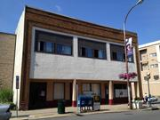 Business partners Chris Maddalone and Chuck Rosenstein are investing $1.4 million to convert the former Spencer Business School building at 202 State St. into 11 loft-style apartments