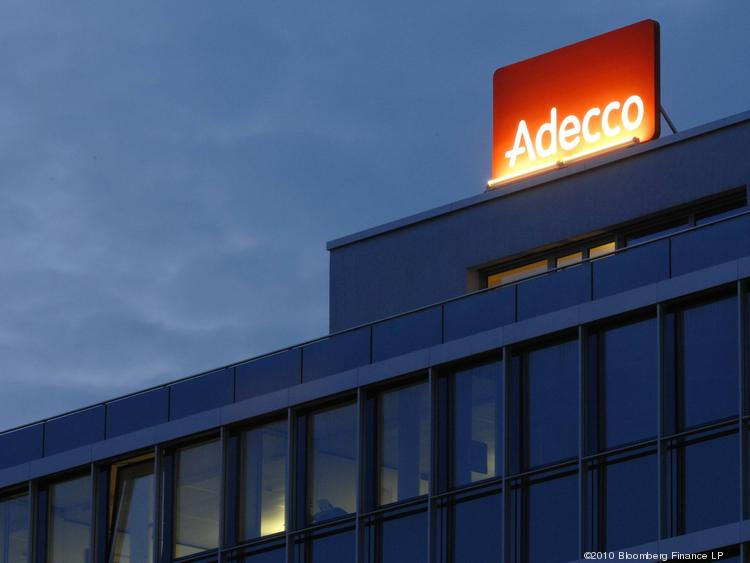 The Adecco SA logo is seen atop the company's headquarters in Switzerland.