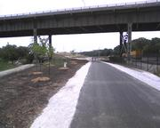The 27th Street and 35th Street viaducts pass over Three Bridges Park.
