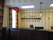 The old hospital has been renovated with a bright décor, including a welcoming lobby at the Villages at Historic Silvercrest.