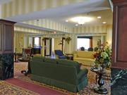 The lobby includes comfortable seating for guests and residents.