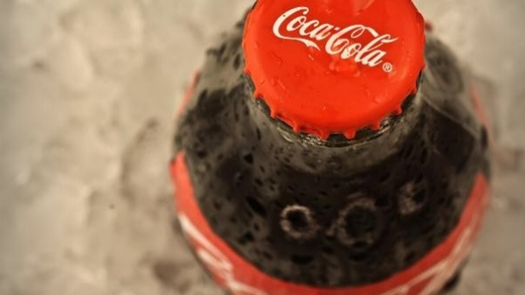 The Coca-Cola Co. is promoting smaller sizes of its cola beverages to consumers.