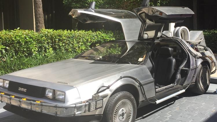 A DeLorean displayed outside the Beacon Council's 30th annual meeting, equipped with time travel options.