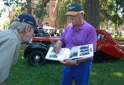 1948 Bentley Mk V1 owner Ron Rezek shows the book he had made on the history of his Coachbuilt classic.