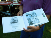 1948 Bentley Mk V1 owner Ron Rezek shows the book he  had made on the history of his Coachbuilt classic. In 1950 it was owned by Prince of Iraq Abd al-Ilāh.