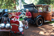 Craig Hannum sits on the back of his 1926 Rolls Royce and enjoys a relaxing lunch with friends.