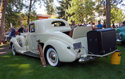 This 1938 Packard owned by Matt and Karla Hackney has style but no trunk. A rumble seat took up the trunk so a leather trunk was added later for luggage.
