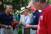 Senior Judge Ken Gross, center,international car expert, was in town to oversee the judging of the show.