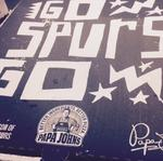 Spurs strike new deal with Papa John's Pizza; local artist gets a slice of the action