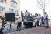 """Members of the Teamsters Union's Transportation Department unload lighting equipment on Cowper Street on the set of Mike Judge's """"Silicon Valley."""""""