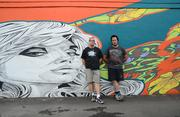 Hideaway Bar owner Chip Critcher (left) later commissioned a second mural from Spear (right) for the side of the building.
