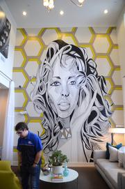"""""""It's an ice breaker. You don't expect to see something like that in an office,"""" says Steelhouse Apartments representative Conrad Hicks of Spear's mural in their Orange Avenue leasing office."""