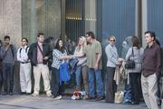 """Extras representing the locals line up to get ready for Mike Judge's """"Silicon Valley"""" shoot."""