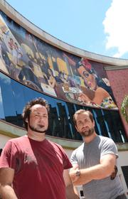 Spear and Metro Finishes co-owner Charles Markin (right) at their Cuba Libre mural at Pointe Orlando.