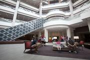 A sitting area provides a place for guests to relax during check in or while waiting for friends in the lobby.