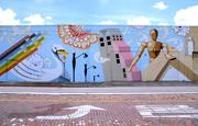 Speaking of Sam Flax - Spear's company, Metro Finishes, was responsible for the expansive mural on their former location. The art was recently vandalized but efforts are under way to restore it.