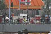 Universal construction crews work on the statue area of Springfield's founder Jebediah Springfield.