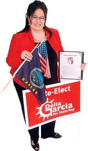 "Delia Garcia - Member, Kansas House of Representatives and assistant manager, Connie's Mexico Café ""The American and Kansas flags represent who I am. My yard sign is in my favorite signature color red, and a  Connie's Mexico Café menu."""