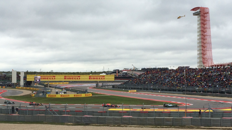 Formula 1 cars zip around the Circuit of The Americas track during the 2015 U.S. Grand Prix.
