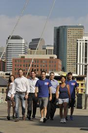 The Beck Group walks over millennium bridge with their pedometers. The company was the No. 1 Healthiest Employer for 2013 in the small-sized business category.
