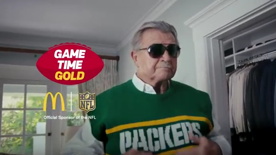 571bea6b Mike Ditka wears a Green Bay Packers sweater-vest to sell McDonald's ...