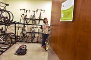 Jessica Crow, IT manager at DaVita, parks her bike after riding into to work on Bike to Work Day. The company was the No. 1 Healthiest Employer for 2013 in the large business category.