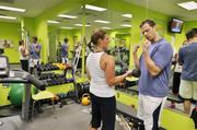 A personal trainer onsite, Jonathan Van Arsdale of Millennium Fitness Solutions works with Pinnacol Assurance's Courtney Efaw, Spanish services representative. The company was the No. 2 Healthiest Employer for 2013 in the large business category.