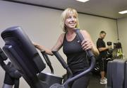 Catherine Reeves, operations specialist at Restaurant Solutions Inc., works out on the elliptical in their onsite gym. The company was the No. 4 Healthiest Employer for 2013 in the small-sized business category.