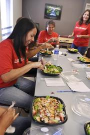The wellness committee enjoys salads for lunch at Security Service Federal Credit Union. The company was the No. 2 Healthiest Employer for 2013 in the small-sized business category.