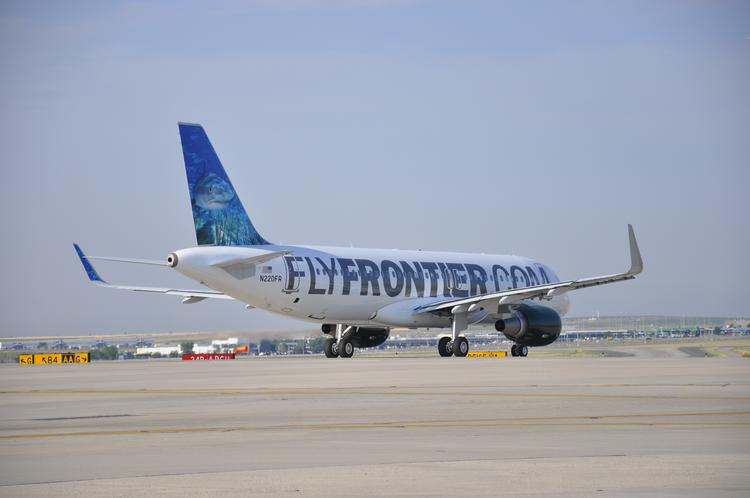 A Frontier Airlines jet with sharklets -- eight-foot-tall wing-tip devices that help save fuel and enhance aircraft efficiency -- and the Denver-based carrier's new shark mascot.