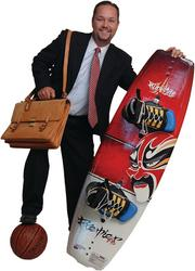 "Tyson Langhofer - Partner, Stinson Morrison Hecker LLP ""I chose a briefcase, wakeboard, basketball,and Bible because they each represent important areas of my life: work, family, fun, and faith. The briefcase obviously represents my work as an attorney. The wakeboard represents my family because I love spending time with my family on the lake and doing other outside activities. The basketball represents the activities I love to do in my free time such as playing basketball and other sports. The Bible (which I brought to the photo shoot but is not pictured)represents my faith in Jesus Christ."""