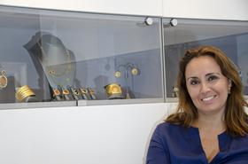 Andrea Hansen co-founded Luxe Intelligence with Courtney Cohen with the goal of providing a full range of branding services to jewelery designers, including connecting them with retailers. Behind her in the showcase are pieces from HIlat, an Istanbul-based designer known for making 24-karat gold pieces.