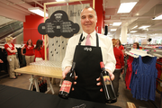 Caterer Gerry McGarvey displays Oregon wines served during the grand opening festivities at Portland's new CityTarget.