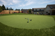 Southern Exposure, by Haggart Luxury Homes, has a putting green and sport court.