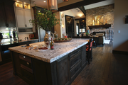 The kitchen at Cuvee, by Elite Development Northwest LLC, flows into the living room.