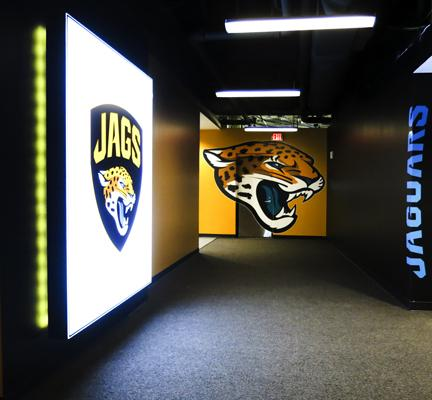 The Jacksonville Jaguars unveiled renovations and new signage throughout EverBank Field like these Tuesday. This is the hallway between the locker room and training room.Click through the photos to see more of the training room.