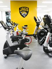 Cardio equipment like exercise bikes and treadmills.
