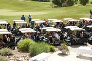 Golfers prepare to head out to the course.
